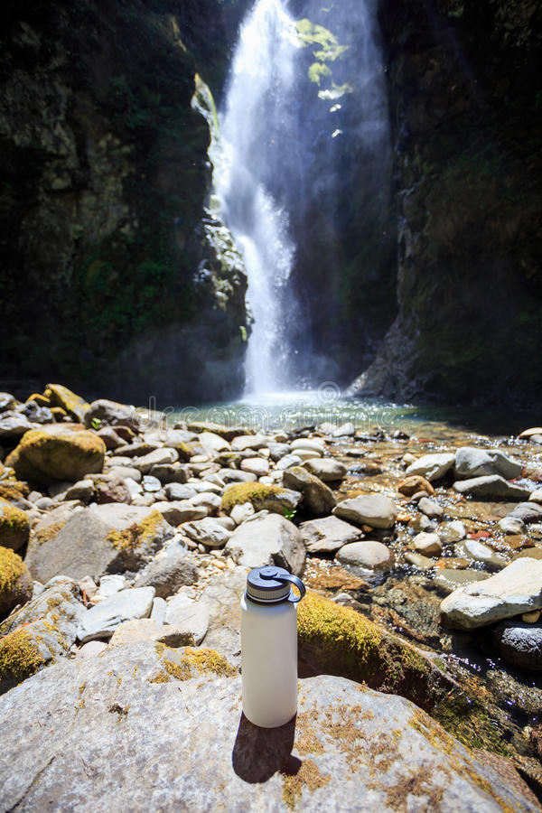 White Water Bottle at Waterfall royalty free stock photography