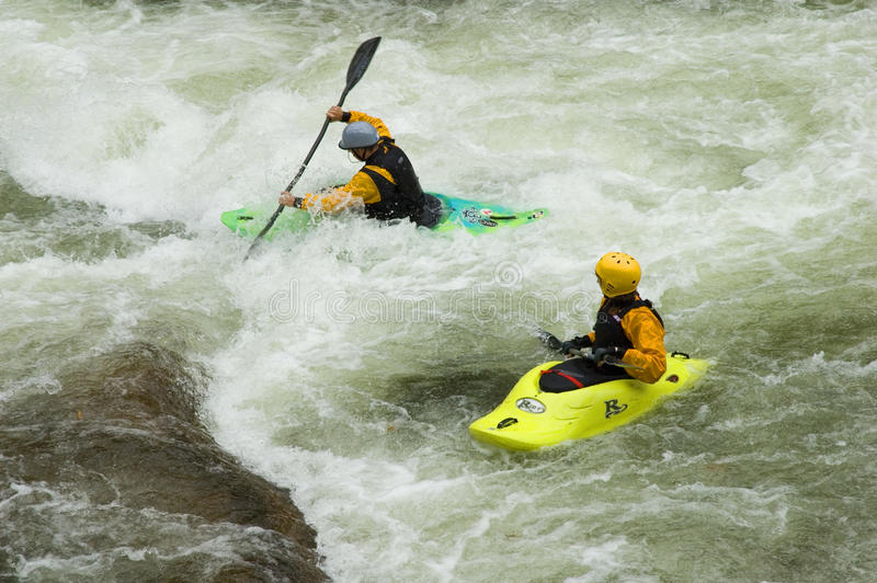 White water kayaking by small water falls royalty free stock photo