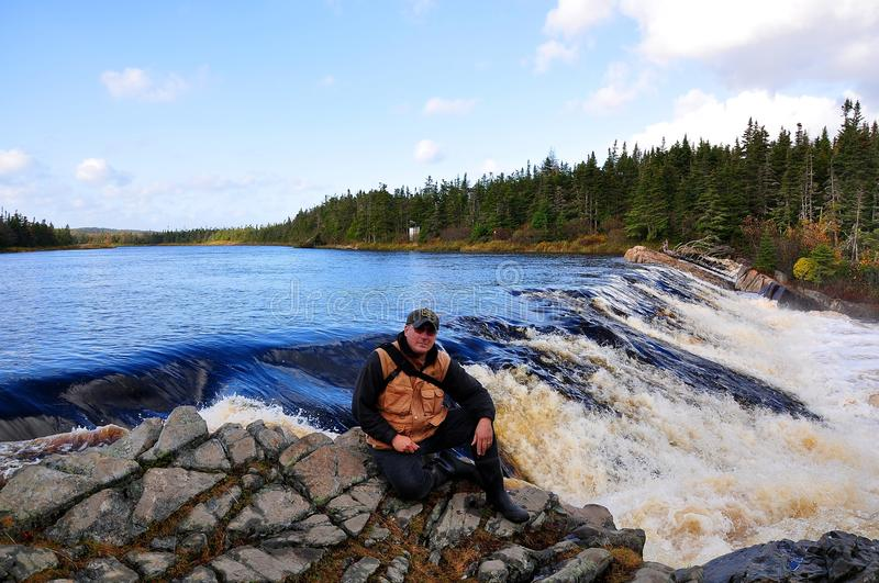 White Water Rapids. A self portrait shot by camera remote near Colinet Newfoundland. Taken at the beginning of a set of white water rapids that would test any stock photos