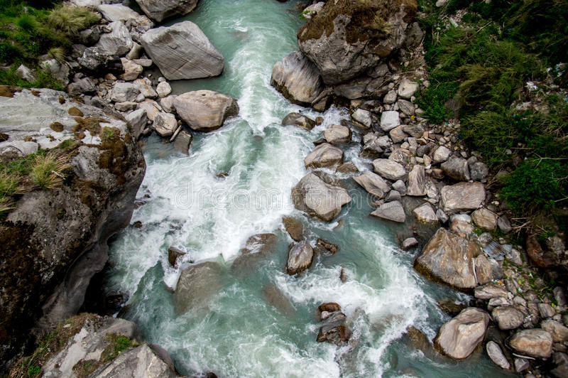 White Water Rapids. The white water from the rapids as the river runs over the rocks stock image