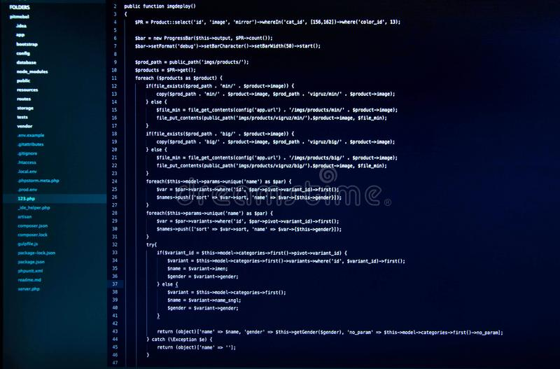 White web application code on the dark blue background. Front view stock images