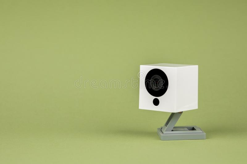 White webcam on green background, object, Internet, technology concept.  royalty free stock photos