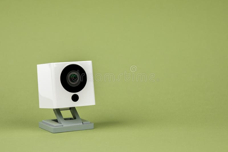 White webcam on green background, object, Internet, technology concept royalty free stock image