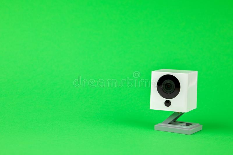 White webcam on green background, object, Internet, technology concept royalty free stock photography