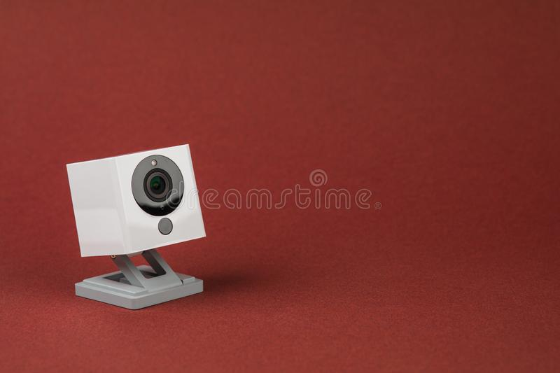 White webcam on red background, object, Internet, technology concept stock photos