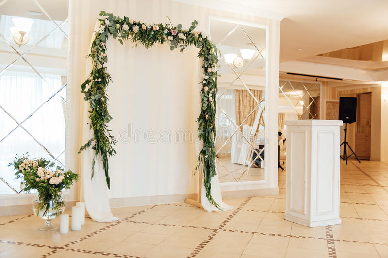 White wedding arch decorated with flower indoor stock image download white wedding arch decorated with flower indoor stock image image of flowers holiday junglespirit Choice Image