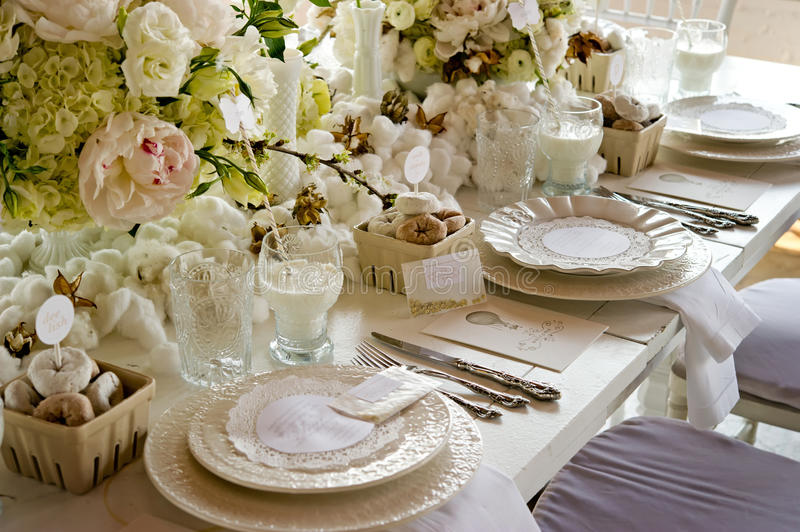White wedding Banquet Table With Milk & Doughnuts stock photography