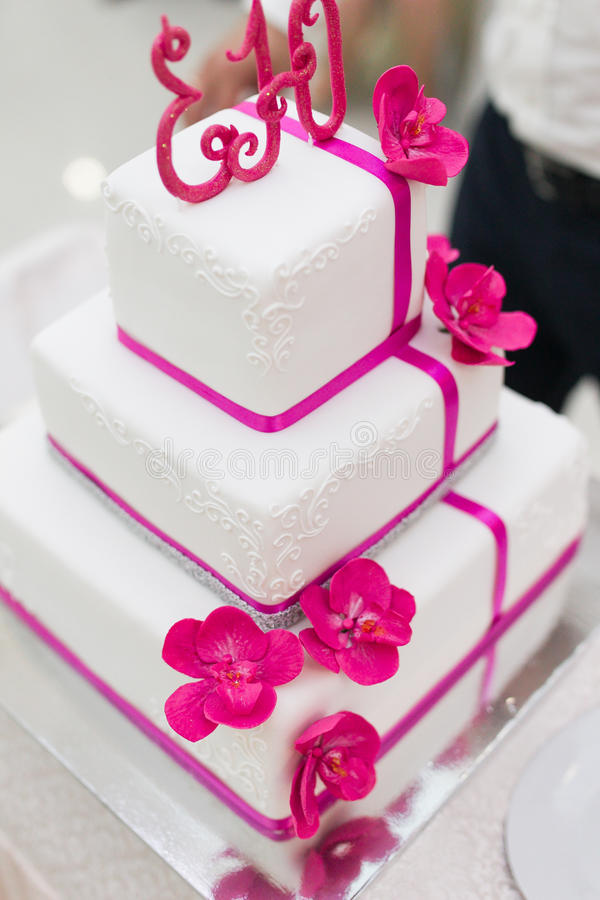 White wedding cake. Beautiful white wedding cake luxury in marriage ceremony royalty free stock images