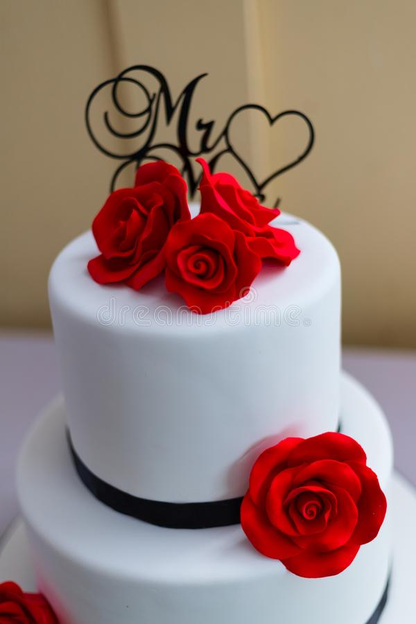 White Wedding Cake With Red Rose Decorations Stock Image Image Of