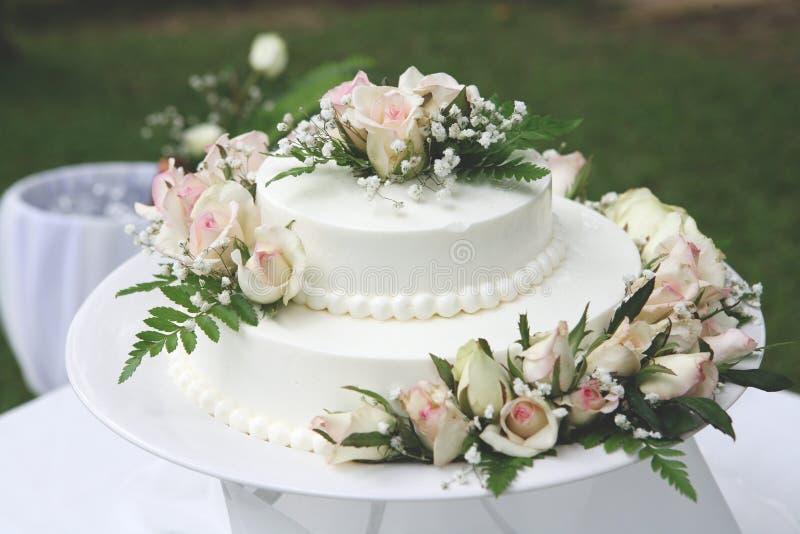 White wedding cake for the wedding ceremony. royalty free stock image
