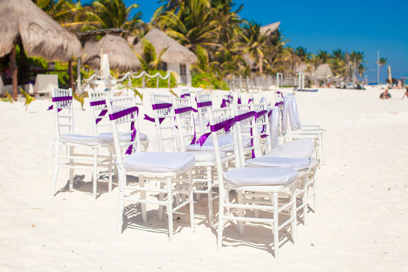 Download White Wedding Chairs Decorated With Purple Bows On Stock Photo