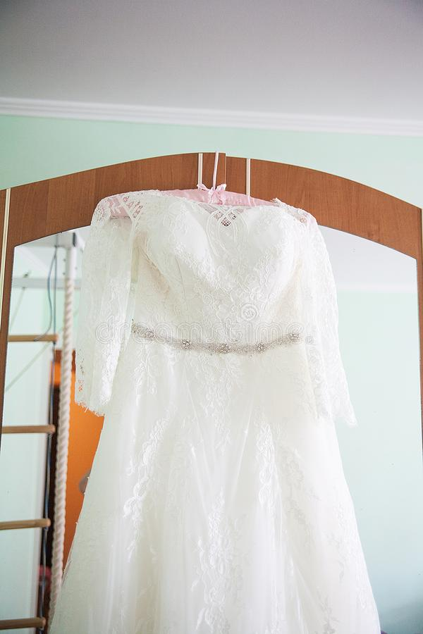 White Wedding dress on a shoulders, before ceremony stock photos