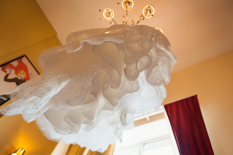 White wedding dress view from below. In a room stock photo