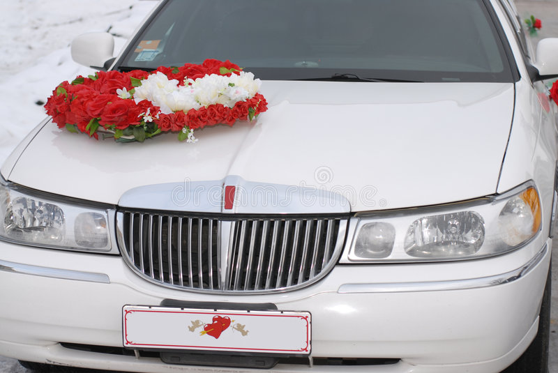 White wedding limousine. With red heart stock photo