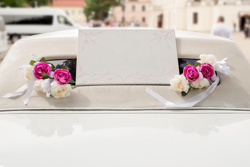 White wedding limousine decorated with flowers royalty free stock photography