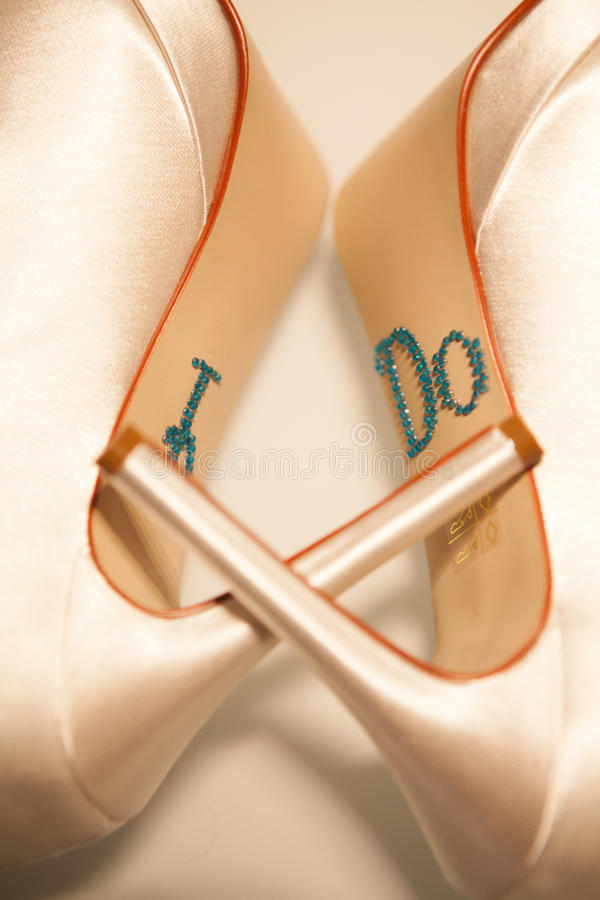 White wedding shoes. Of the bride on her wedding day royalty free stock image