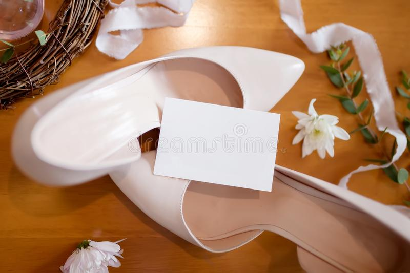 White wedding shoes, copy space. White wedding shoes with natural rustic style decorations, copy space royalty free stock images