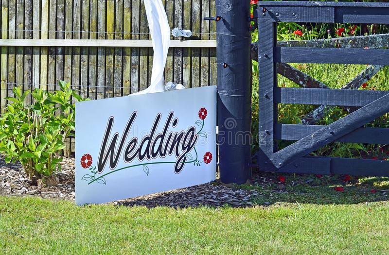 White wedding sign in garden setting venue background royalty free stock images