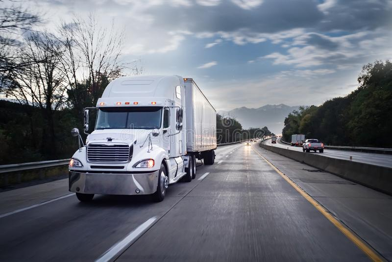 White 18 wheeler truck on highway at night stock photography