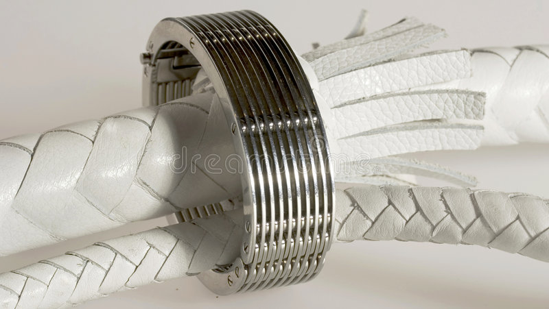 White whip with a bracelet royalty free stock photo