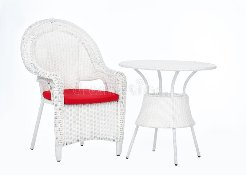 White wicker rattan chair and round table, isolated on a white background royalty free stock image