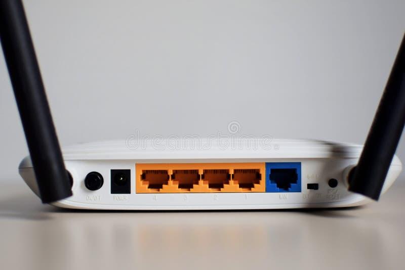 White wifi router with two black antennas stock photo