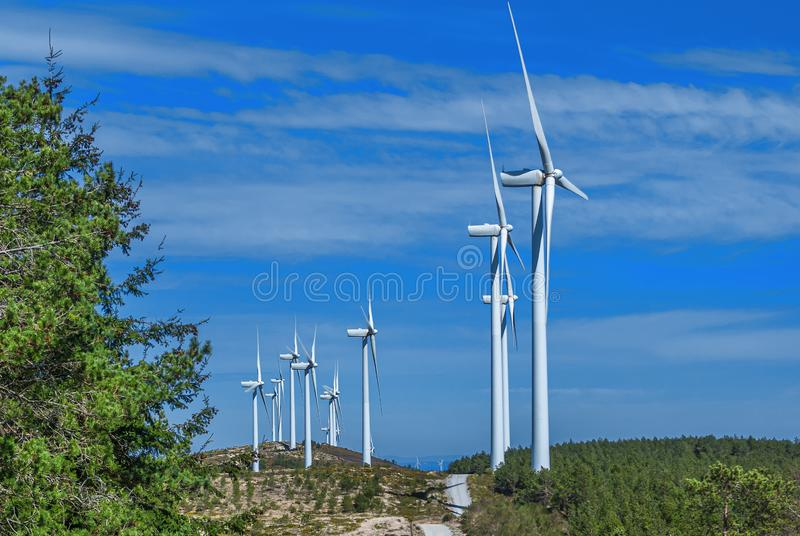 White wind electric turbines and blue sky in spring in Galicia? Spain near the Way of St. James. Camino de Santiago stock photography
