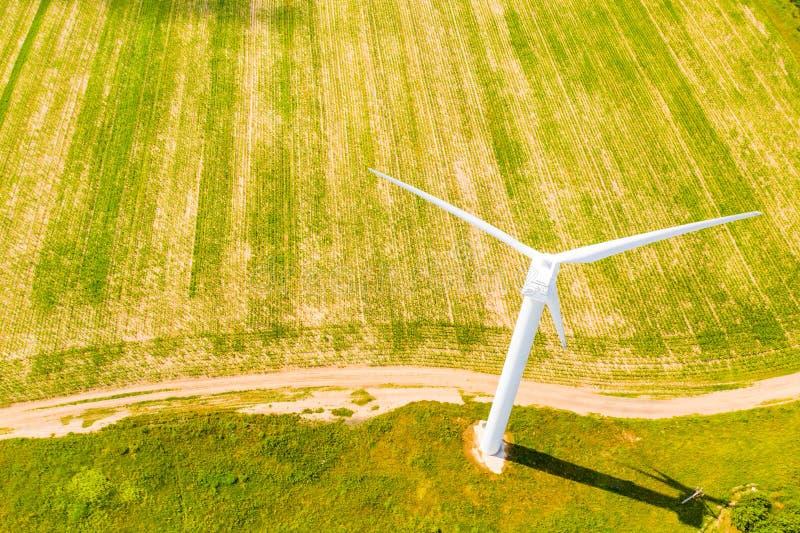 White wind turbine set in green field, aerial landscape. Farmland view royalty free stock photo