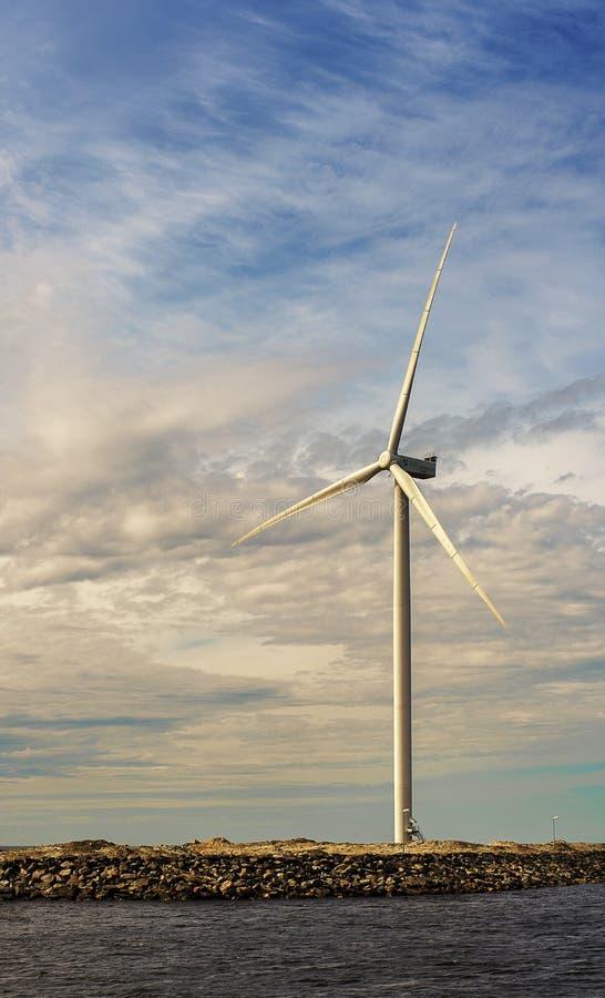White tall windfarm on the sky background near sea. North Bothnia royalty free stock image