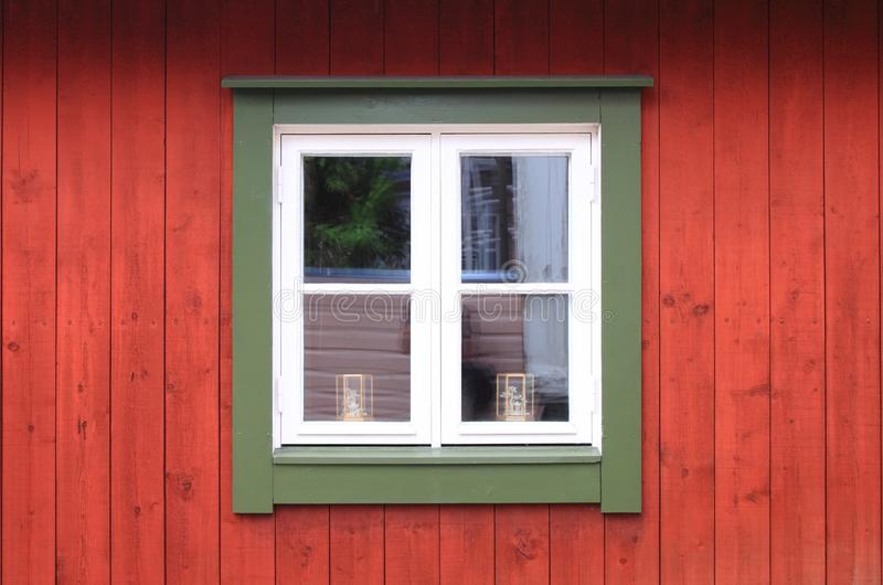 White window in a red wooden wall royalty free stock photos