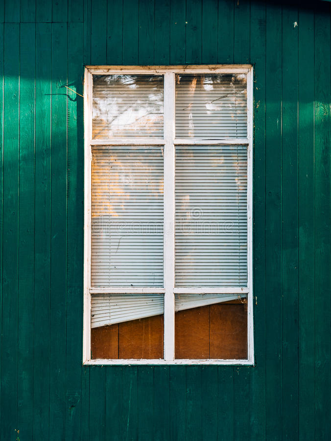 White window shutters. The facade of houses stock photography
