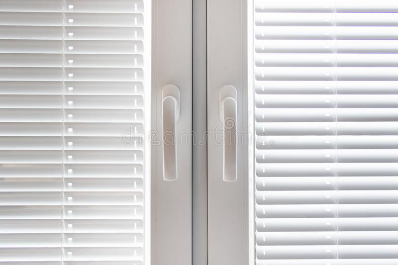 White windows with blinds royalty free stock image