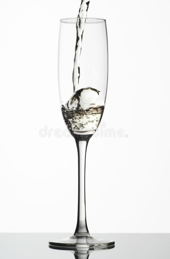 White wine being poured stock photography