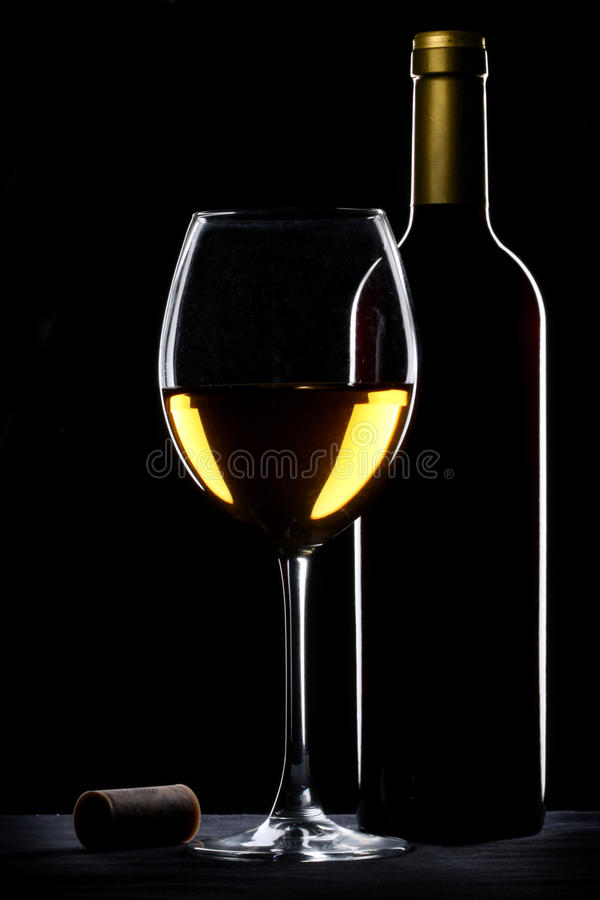 White wine bottle and glass stock photo
