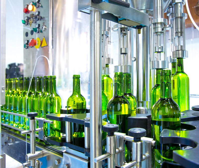 White wine in bottling machine at winery royalty free stock image