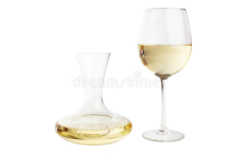 White wine carafe. Wine glass and a carafe filled with white wine, isolted on white royalty free stock images
