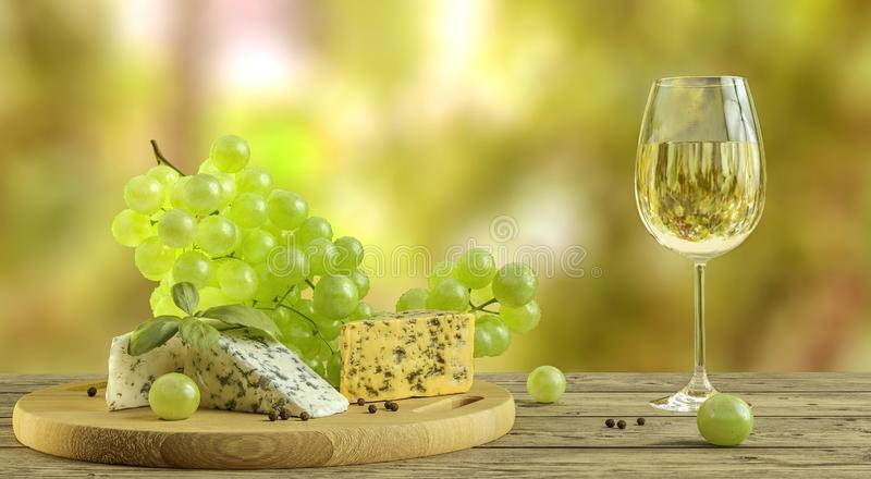 White wine, cheese and grapes on wooden table with blurred wineyard in background royalty free stock photography