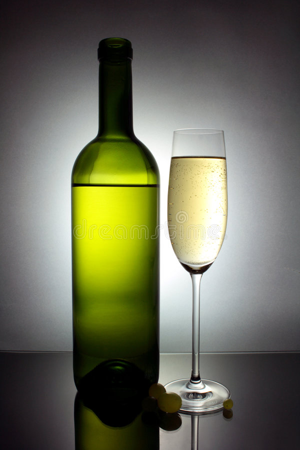 White wine glass and bottle stock photos