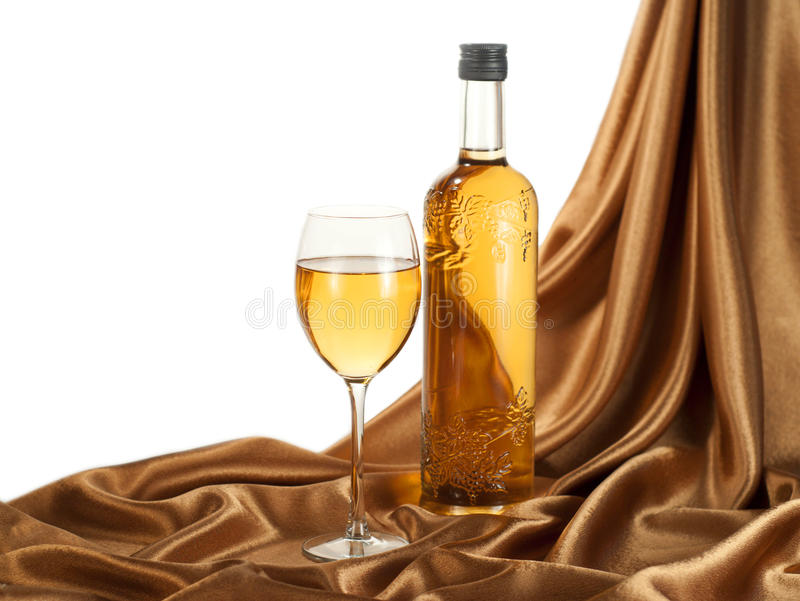 White wine on golden satin royalty free stock images