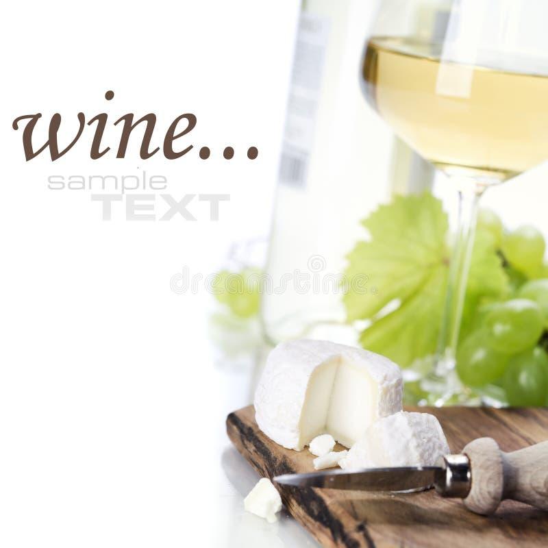 White wine, grape and cheese stock photos