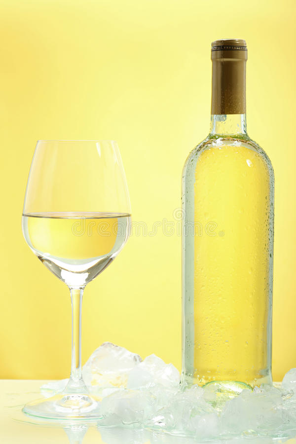 Free White Wine In Glass On Yellow Background Stock Photo - 30690910