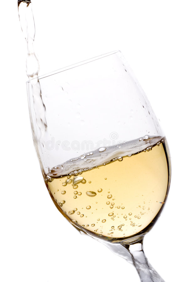 White wine poured into a glass royalty free stock images