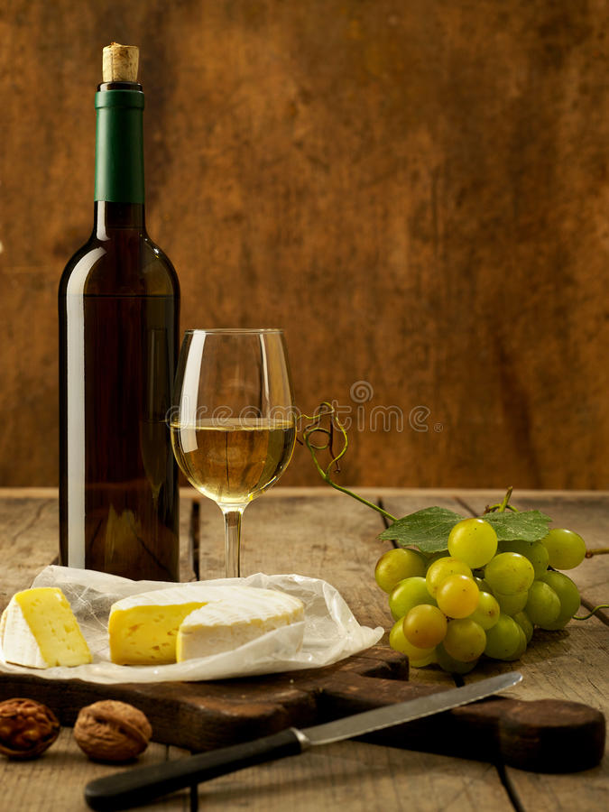 White wine on rustic background royalty free stock images
