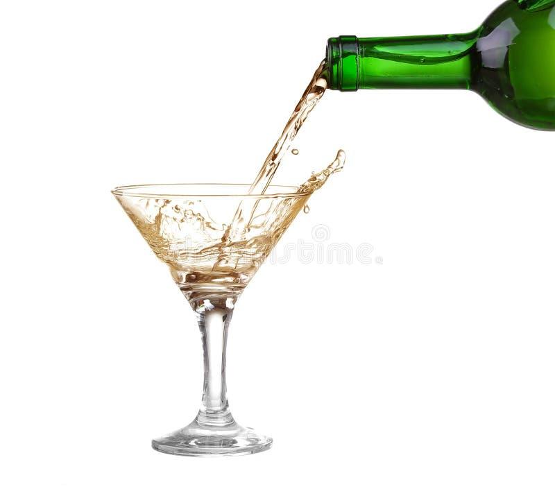 White wine splash isolated on white.  stock photo