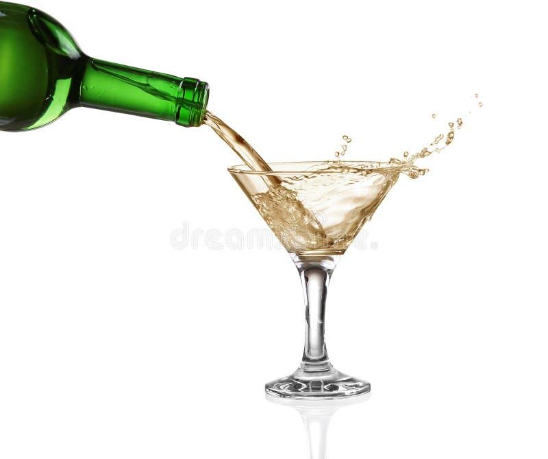 White wine splash isolated on white.  stock photos