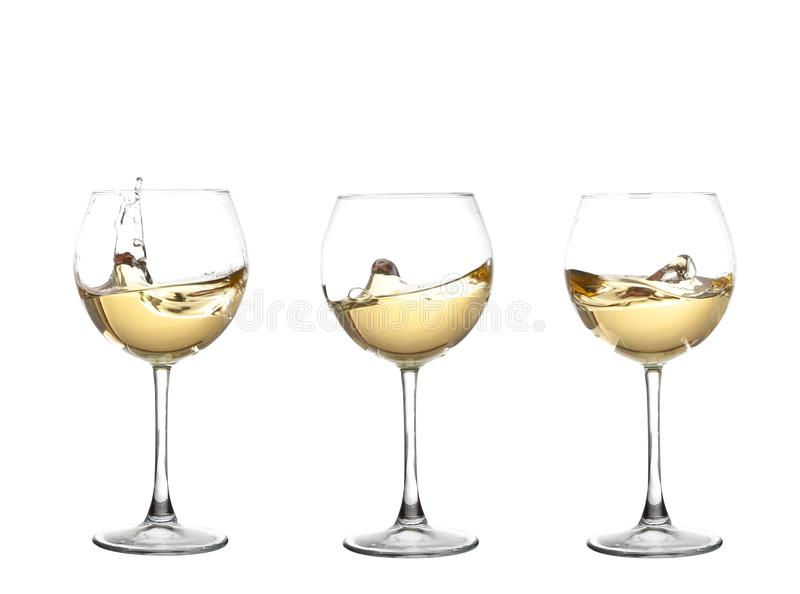 WHITE wine swirling in a goblet wine glass, isolated on a white. Background stock photography