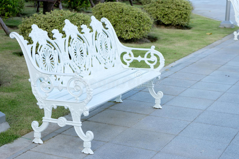 White wintage bench. In the nature park morning time stock photo