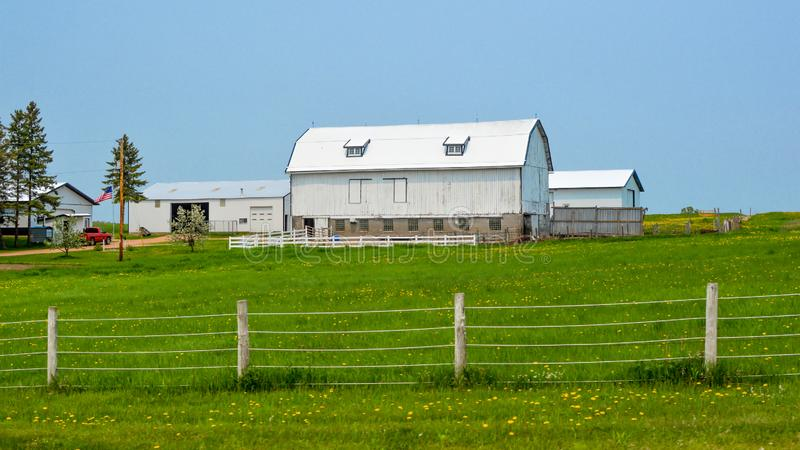 White Wisconsin Barn with Fence stock image