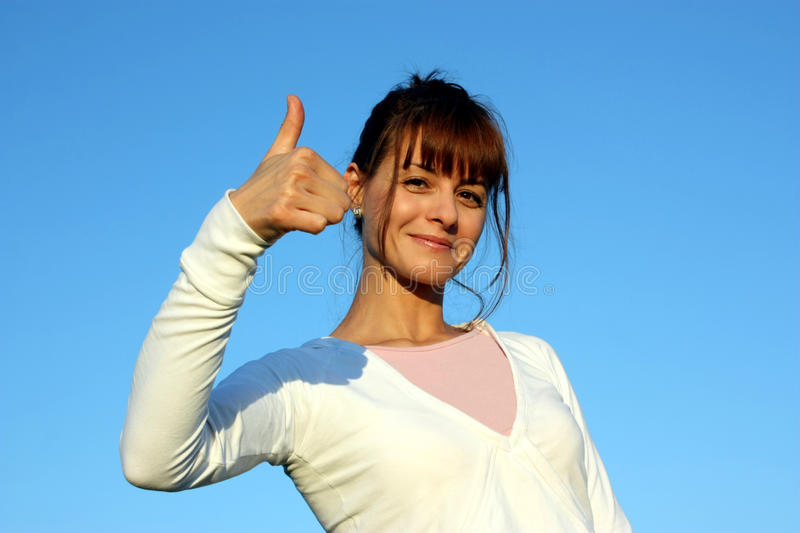 A white woman on a blue sky royalty free stock image