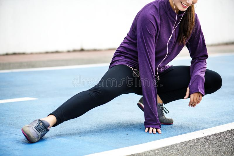 White woman stretching before exercise royalty free stock image